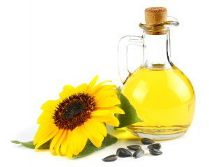 Sunflower seed oil with sunflower head and seeds