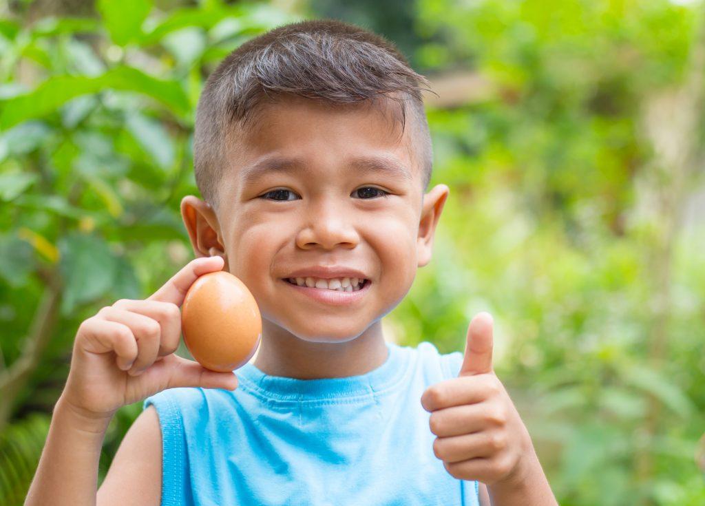 Child holding an egg